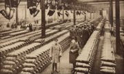King George V and officials inspecting munitions factory in 1917