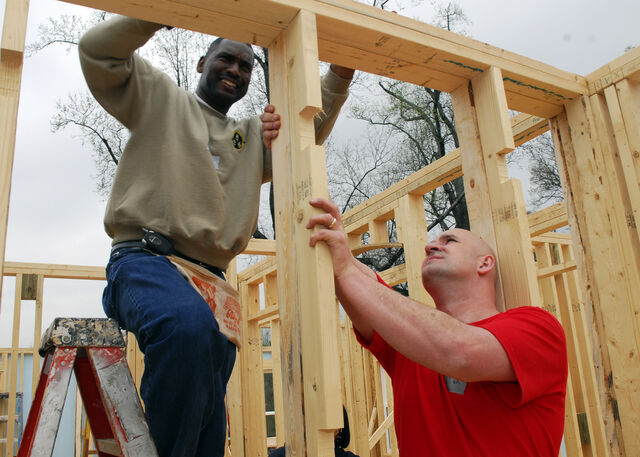 File:US Navy 070315-N-2903M-002 Master Chief Machinist^rsquo,s Mate Calvin Watson and Electronics Technician 1st Class James McCartney build wall frames in a new house as volunteers for Habitat for Humanity.jpg