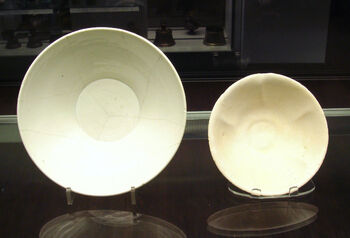 Chinese white ware and Iraqi earthenware bowls 9th 10th century both found in Iraq