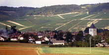 1280px-A village with vineyards in Champagne, France 1987