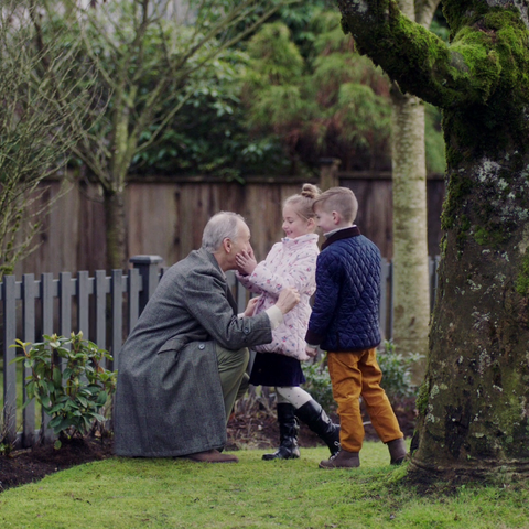Old Carter with his grandchildren