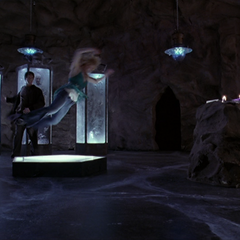 Billie is thrown across Burke's lair by his Super Strength.