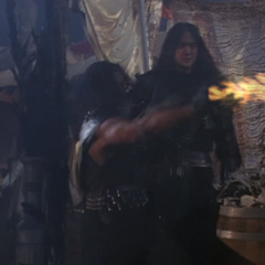 A Demon using Fire Throwing to attack Piper and Phoebe.
