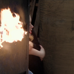 A Demon throws another fireball at Phoebe and Paige.