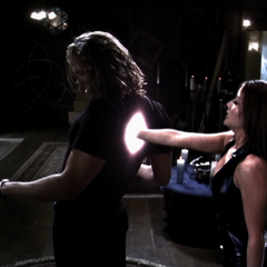 Bianca 'holds' Wyatt as she tries to strip him of his powers.
