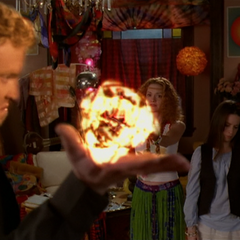 Nigel throws a fireball at Penny and Piper, but Allen jumps in front of it.