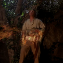 Xavier throws fire at the Satyr.
