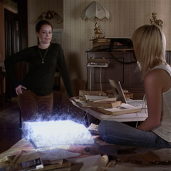 Paige orbs the Book of Shadows to her.