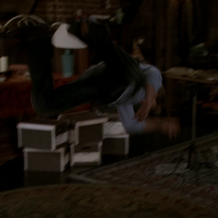 Leo is thrown across the attic due to Infected Piper's Super Strength.