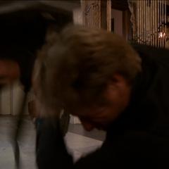 Penny flings a table against Nigel.