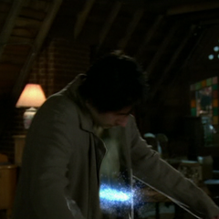 Paige orbs a piece of glass into a Scabbar Demon.