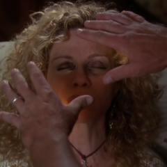 Leo heals Lydia's eyes.