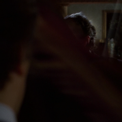 Gideon telekinetically opens the curtain in his office.