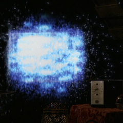 Paige orbs a television towards Leo.