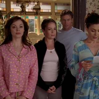 The Charmed Ones and Leo getting ready to cast the spell.