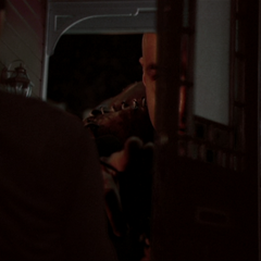 Savard telekinetically closes the front doors of the doll house.