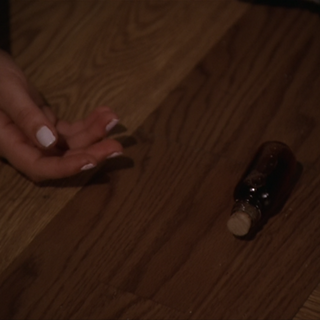 The potion lying on the floor.