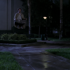 Marcus hovering in a park whilst meditating.