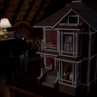 The Charmed Ones trapped inside the Doll House.