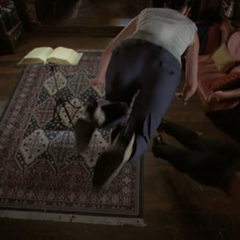 Phoebe levitates to dodge the Kazi Demon.