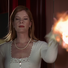 Mandi (possessed by the Possessor Demon) sets Wyatt's costume on fire.