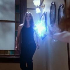 Paige telekinetically orbs an energy ball to Janna.