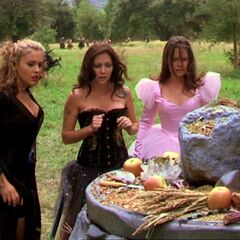 The Charmed Ones around an altar with objects associated with Natural magic.