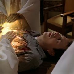 The Elders combining their Healing powers to heal Marcus.