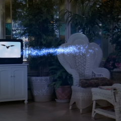 Wyatt projects a Dragon out of the TV.