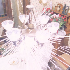 Bacarra, using Piper's power, blows up a part of the chandelier.