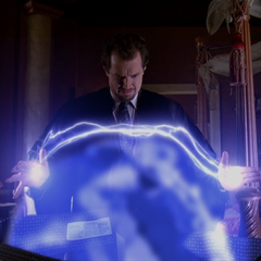 Gideon creates lightning bolts to make contact with Wyatt's force field.