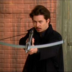 A darklighter holds his crossbow; ready to shoot Leo