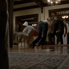 The Charmed Ones are flung by a Cleaner.
