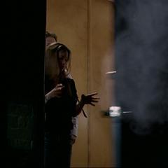 Piper blasts open Phoebe's condo's door.