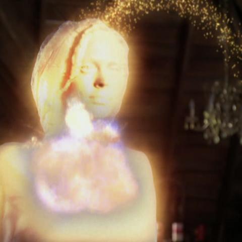 Phoebe hits petrified Paige with a potion.