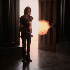 Christy attacks Billie and the Charmed Ones with a fireball.