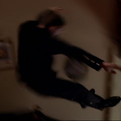 Billie telekinetically throws the Demon into a wall.