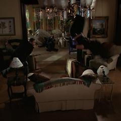 Billie telekinetically simulating Levitation to dodge Elkin's fireball.