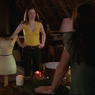 Piper testing out potions on a mannequin.