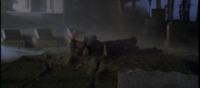 Cole ruffling the fake grass in S3E8