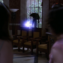 An energy ball is thrown at Paige and Phoebe.
