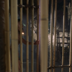 A Valkyrie magically unlocks the cage door.