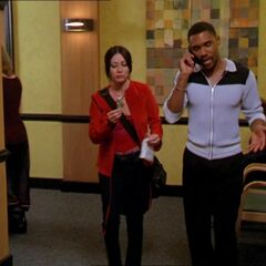 Prue Halliwell talking with Gil Corso, the manager