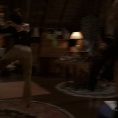 Phoebe is thrown across the attic as she is hit by the Manticores' Super Strength.
