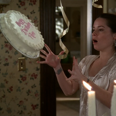 Piper freezes the cake.