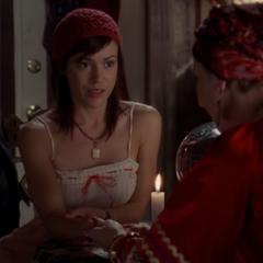 Teresa reads Phoebe's palm.