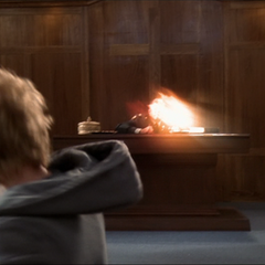 Sirk throws an fireball at Arthur.