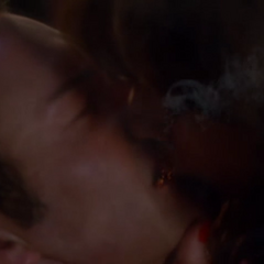 The Siren uses her Kiss of Death on Cole.