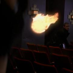 Elkin throws a fireball at Billie.