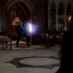 Patra (shapeshifted into Paige) orbs the Energy Ball back at the Demon.